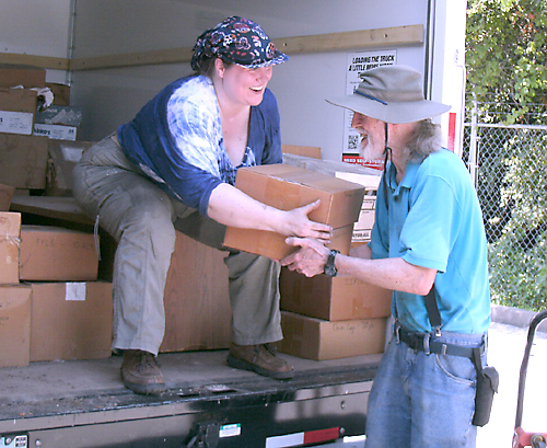 Piers and daughter unload boxes July 2014